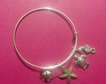 Silver plated bangle with beach and sea life bangle