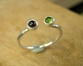 adjustable dual garnet and peridot gemstone sterling silver ring.