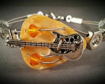 "Guitar pick and guitar string bracelet ""Peach Guitar"""