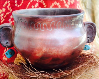 Clay pot with earrings, burnished and smoked fired.
