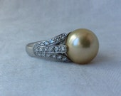 South Sea Pearl and 1 Carat accent Diamonds in a 18k Mounting Signed BJC