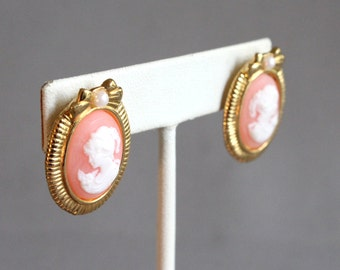 Vintage gold tone post earrings with pink plastic cameo, bow tie design
