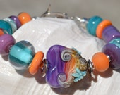 Reserve for Sandi-SEA SUNSET-Handmade Lampwork and Sterling Silver Bracelet