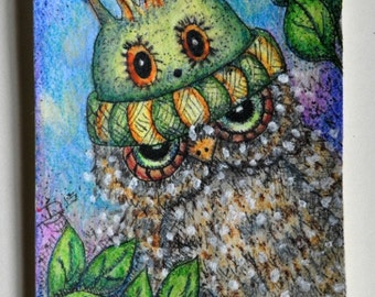Artist trading card,ACEO, painting of cute whimsical owl wearing a green monster stocking cap.