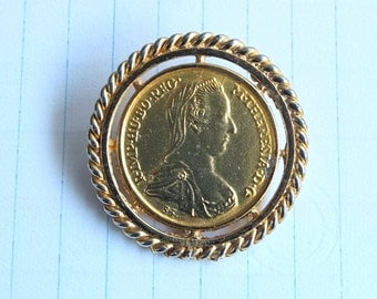 Antique Feminine Metal Pound Brooch