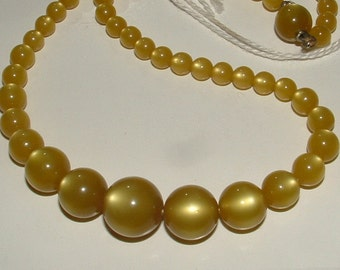 MOONGLOW  soft olive green or pea soup color- full strand graduated beads lots of glow 1950s