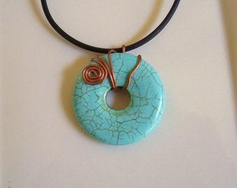 Turquoise Colored Magnasite Donut Pendant