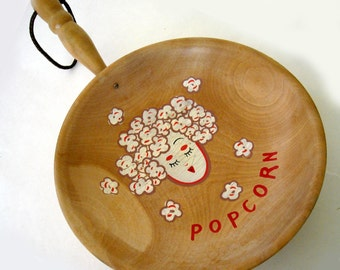 vintage whimsical wooden hand designed decorative hanging frying pan with popcorn