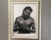 Cross stitched portrait of Charlie Hunnam shirtless