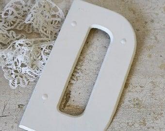 white letter D