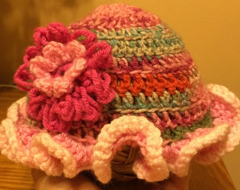 Adorable Fun and Colorful Crochet Hat with Ruffled Rim and Fluffy Flower