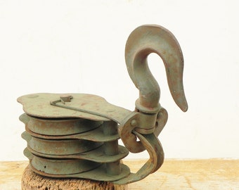 Salvaged heavy duty metal industrial pulley chippy rusty green