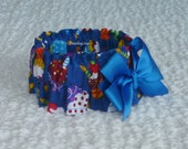"Cupcakes on Dark Blue Dog Scrunchie Collar with yellow bow - Size S: 12"" to 14"" neck"