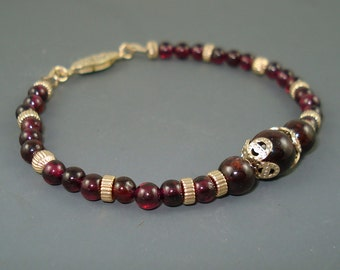 Garnet Bracelet, Small Garnet Beads With Large Center Bead, Gold Filled Spacer Beads and Caps
