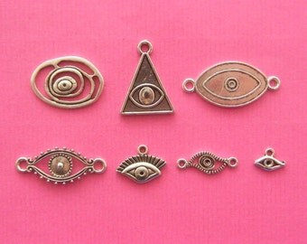 The Eye Collection - 7 different antique silver tone charms