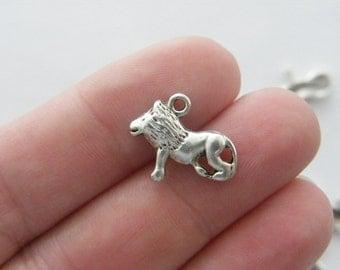 14 Lion charms antique silver tone A26