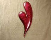 A Red carved wooden heart wood carving Wedding Gift for the couple