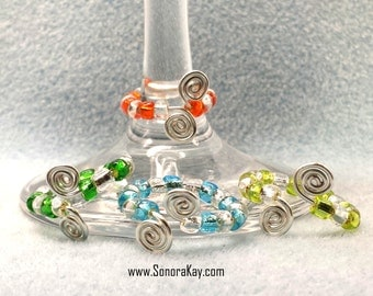 Set of Four Glass Beaded Ring turned Wine Charms