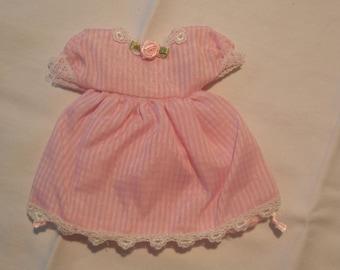 Bag of Twelve Party Favor Gift Bags in Pink Dress Form.