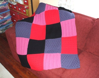 Hand knit afghan in 20 percent  Wool and 80 percent Acrylic