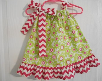 Lime green floral pillowcase dress with hot pink and white chevron ruffle and tie infant through 6 years