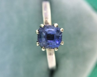 Blue and Askew - a quirky sapphire solitaire