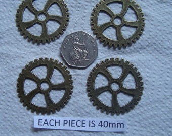 4 Steampunk cogs each cog is 40mm  and is made from metal alloy the colour is bronze