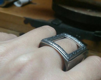 mens TATTOO ring. 22mm x 14mm inside of the rectangle frame, huge. Put a RING on IT. Plain back. Not personalized. Solid sterling silver.