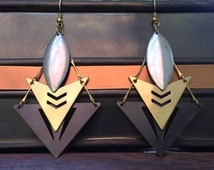 Large tribal geometric multi tone earings with bright raw brass, silver tone marquis tear drop, and antiqued brass triangle with cut out