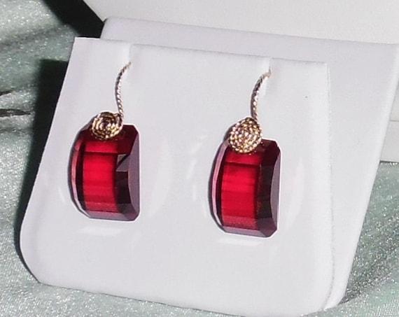 47 cts Natural Fancy CKB Red Topaz gemstones, 14kt yellow gold Pierced Earrings