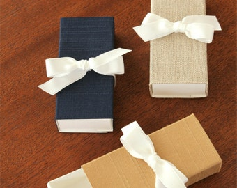 USB Flash Drive Box. Shown in Gold, Navy Blue, and Natural Linen Fabric