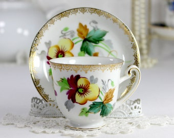 Cutie Demitasse Teacup and Saucer, Hira China, Pansies Motif, Occupied Japan 12526