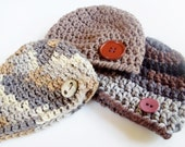 Baby boy beanies.  Choose the one you like. Sizes 0-12 months