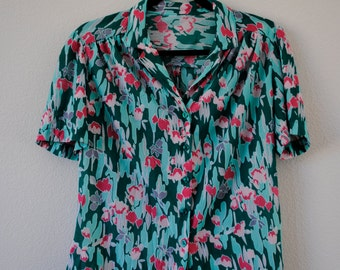 a vintage 70s bright green, pink, and mint button down floral print blouse. sz medium.