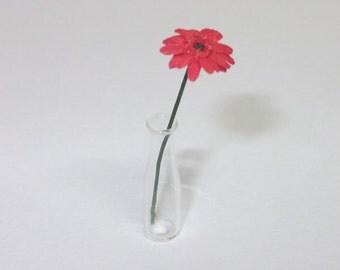 Dollhouse miniature gerbera flower in a bottle