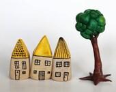 Set of three yellow miniature houses