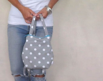 Polka dot backpack purse. Small backpack with zipper closure and adjustable straps in gray with white polka dots. Choose zipper color.