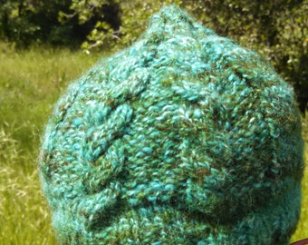 cabled handknit wool hat in mountain green color made from handspun wool