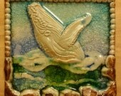 Breaching whale art handsculpted stoneware with fused glass greens blues