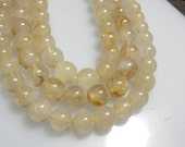gorgeous 14 inches golden rutilated quartz  plane smooth round beads  huge size 10MM Approx