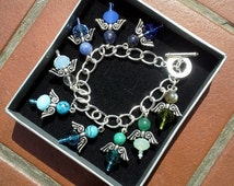 Crystal Angel Charm Bracelet with multiple blue and green crystal beads,