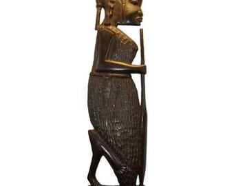 Hand carved ebony profile sculpture.