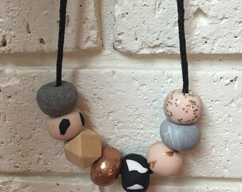 Greys/rose gold polmer clay beaded necklace on adjustable leather cord