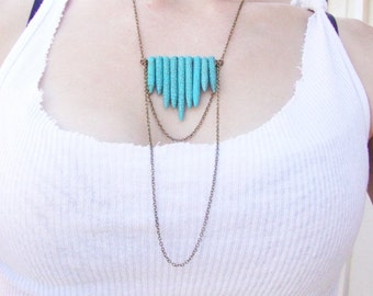 Turquoise tribal howlite spear and antique brass chain necklace