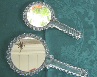 Rare and unusual glass hand mirrors