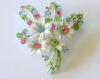 white flower brooch with rhinestones