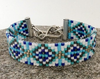 Beaded bracelet with Vintaj pewter heart closure with an arrow toggle.