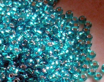 11/0 Teal Glass Seed Beads - Silver Lined - Item # BG110A