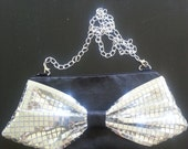 Bow Clutch - Black Faux Leather Body with Silver Flat Sequin Bow, Silver Chain Strap, Black and White Gingham Lining and Black Zipper