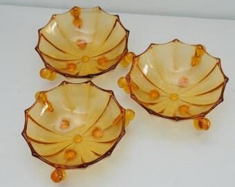 Three Amber Glass Bowls